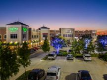 Shoppes at Quail Springs retail space for lease Oklahoma City, OK exterior night  photo