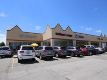 Olympia Plaza Shopping Center for Sale - 7202 W Hefner Rd